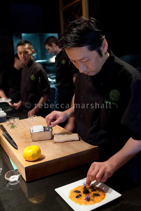 Head chef Takeo Yamazaki prepares salmon yuzu at Yoshi restaurant at the Metropole Hotel, Monaco, 23 March 2012