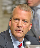 """United States Senator Dan Sullivan (Republican of Alaska) listens to the testimony before the United States Senate Committee on Armed Services concerning """"Impacts of the Joint Comprehensive Plan of Action (JCPOA) on U.S. Interests and the Military Balance in the Middle East"""" on Capitol Hill on Wednesday, July 29, 2015.<br /> Credit: Ron Sachs / CNP"""
