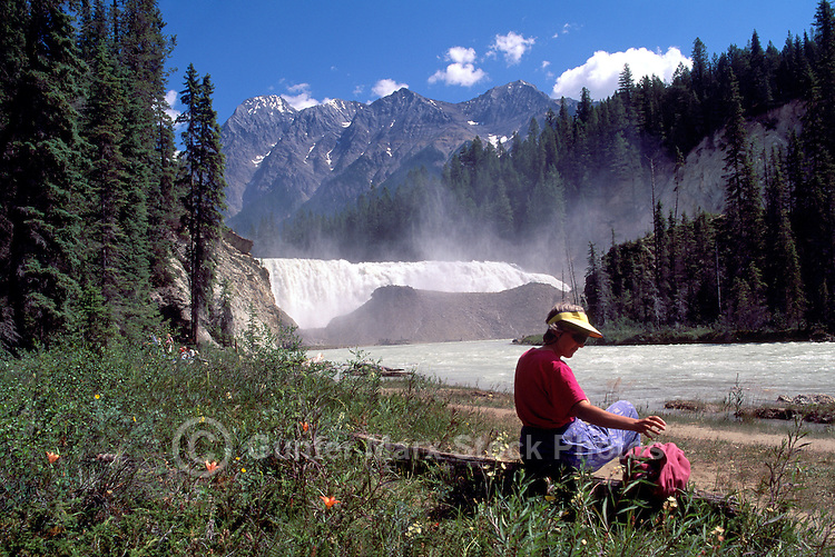 Yoho National Park, Canadian Rockies, BC, British Columbia, Canada - Hiker resting beside Wapta Falls, Kicking Horse River, Summer (Model Released)