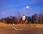 The Presque Isle Lighthouse At Sunset With A Moon OnThe Rise, Erie Pennsylvania, USA