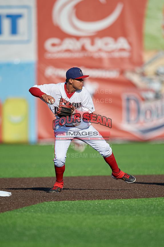 Auburn Doubledays shortstop Jose Sanchez (44) throws to first base during a NY-Penn League game against the West Virginia Black Bears on August 23, 2019 at Falcon Park in Auburn, New York.  West Virginia defeated Auburn 8-1, the first game of a doubleheader.  (Mike Janes/Four Seam Images)