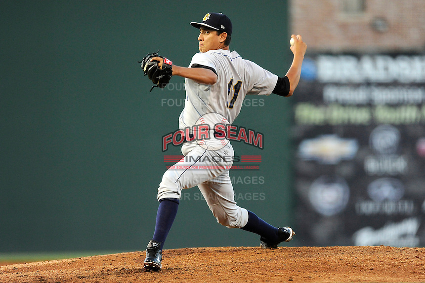 Starting pitcher Giovanny Gallegos (11) of the Charleston RiverDogs delivers a pitch in a game against the Greenville Drive on Wednesday, April 16, 2014, at Fluor Field at the West End in Greenville, South Carolina. Charleston won, 8-7. (Tom Priddy/Four Seam Images)