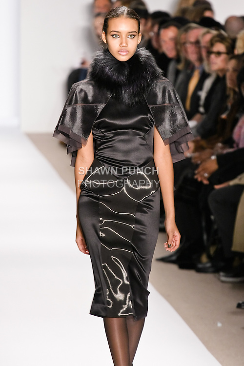 Chriselle Stubbs walks the runway in a gunmetal russian broadtail and fox capelet with net inserts, and black charmeuse and liquid wool dress, by Dennis Basso for his Dennis Basso Fall Winter 2010 collection fashion show, during Mercedes-Benz Fashion Week Fall 2010.