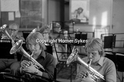 The  Frickley Colliery Band  rehearsals. South Kirkby Colliery, Yorkshire Coal Miners story  England. 1979. <br /> <br /> Front Row. Left to right ?? and Brian Till.<br />  <br /> IF YOU KNOW THE NAMES OF ANY OF THE MEN IN THESE IMAGES PLEASE LET ME KNOW, I WOULD LIKE TO BE ABLE TO PUT A NAME TO A FACE. THANKS.