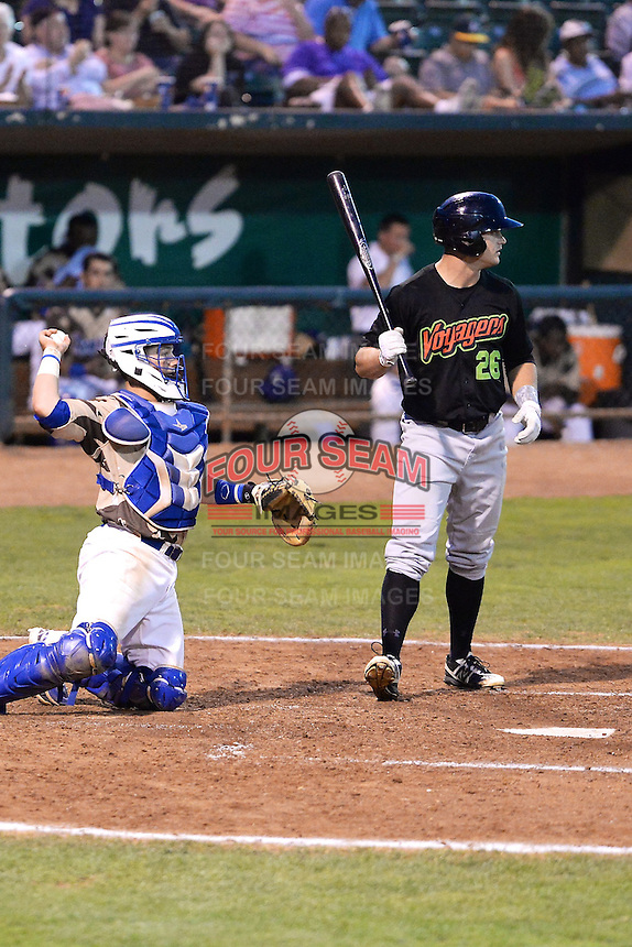 Adam Engel (26) of the Great Falls Voyagers at bat against the Ogden Raptors with Austin Cowen (15) of the Raptors behind the plate at Lindquist Field on August 16, 2013 in Ogden Utah. Military Appreciation Night saw the Raptors take the field in camouflage uniforms. (Stephen Smith/Four Seam Images)