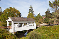 Sandy Creek Bridge is a covered bridge spanning Sandy Creek near the community of Remote in southwestern Oregon in the United States. The bridge crosses the creek near its mouth on the Middle Fork Coquille River in Coos County.
