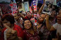 Supporters of Yingluck Shinawatra, sister of ousted premier Thaksin Shinawatra, celebrate at her party's headquarters after voting in general elections ended in Bangkok July 3, 2011. The opposition won Thailand's general election by a landslide on Sunday, exit polls showed, paving the way for Yingluck Shinawatra to become the country's first female prime minister in a victory for a red-shirted political movement. REUTERS/Damir Sagolj (THAILAND)