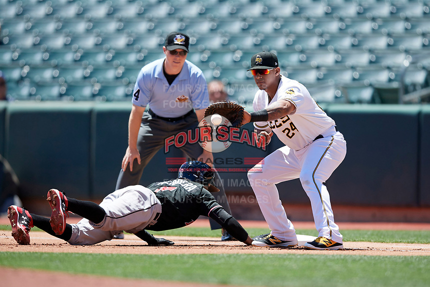 Jefry Marte (24) of the Salt Lake Bees on defense against the Albuquerque Isotopes in Pacific Coast League action at Smith's Ballpark on June 11, 2017 in Salt Lake City, Utah. The Bees defeated the Isotopes 6-5. (Stephen Smith/Four Seam Images)