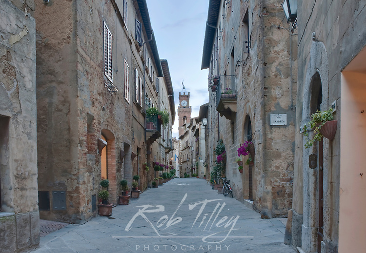 Europe, Italy, Tuscany, Pienza, Midieval Street and Clock Tower in Historic District (Corso Il Rossollino)