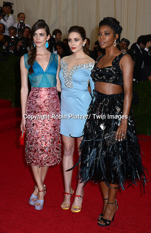 Stacy Martin, Elizabeth Olsen and Gabrielle Union attend the Costume Institute Benefit on May 5, 2014 at the Metropolitan Museum of Art in New York City, NY, USA. The gala celebrated the opening of Charles James: Beyond Fashion and the new Anna Wintour Costume Center.