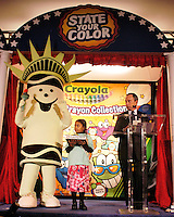 """BROOKLYN HEIGHTS, NY - OCTOBER 26: Tracy Ceschin (L), of New York City, New York portraying the New York state color Crayola crayon """"Lady Liberty"""" is walked onto stage by Georgi Forrest, 8, of Brooklyn, New York  as New York Mayor Michael Bloomberg(R) introduces them during the Crayola State Crayons introduction ceremony at PS8 Tuesday October, 26, 2004 in Brooklyn Heights, New York. Earlier this year, Crayola constituents of all ages nominated existing crayon colors and gave them new state-themed names that draw attention to something special about every state in the union. Fifty winners were selected by Crayola from more then 25,000 names entered. """"Boston Tea Party"""" for Massachusetts and """"Alamo a la mode"""" for Texas represent the Presidential candidates home states.(Photo by William Thomas Cain/photodx.com)"""