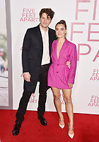 WESTWOOD, CA - MARCH 07: Brett Dier (L) and Haley Lu Richardson attend the Premiere Of Lionsgate's 'Five Feet Apart' at Fox Bruin Theatre on March 07, 2019 in Los Angeles, California.<br /> CAP/ROT/TM<br /> &copy;TM/ROT/Capital Pictures