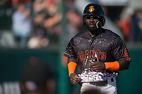 San Jose Giants left fielder Jacob Heyward (33) jogs to the dugout after scoring a run during a California League game against the Lancaster JetHawks at San Jose Municipal Stadium on May 12, 2018 in San Jose, California. Lancaster defeated San Jose 7-6. (Zachary Lucy/Four Seam Images)