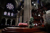Former President George W. Bush speaks in front of the flag-draped casket of his father, former President George H.W. Bush, at the State Funeral at the National Cathedral, Wednesday, Dec. 5, 2018, in Washington. (AP Photo/Alex Brandon, Pool)
