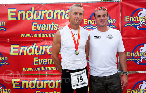 08 AUG 2010 - LICHFIELD, GBR - Paul Thompson (left) celebrates his victory in the Triple Iron race at the Enduroman Ultra Triathlon Championships in a time of 37 hours 55 minutes and 19 seconds with race organiser Steve Haywood (PHOTO (C) NIGEL FARROW)