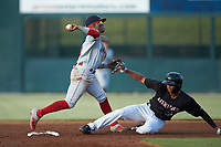 Lakewood BlueClaws shortstop Luis Garcia (3) makes a throw to first base after forcing out Johan Cruz (13) of the Kannapolis Intimidators at second base at Kannapolis Intimidators Stadium on July 18, 2019 in Kannapolis, North Carolina. The Intimidators defeated the BlueClaws 7-1. (Brian Westerholt/Four Seam Images)