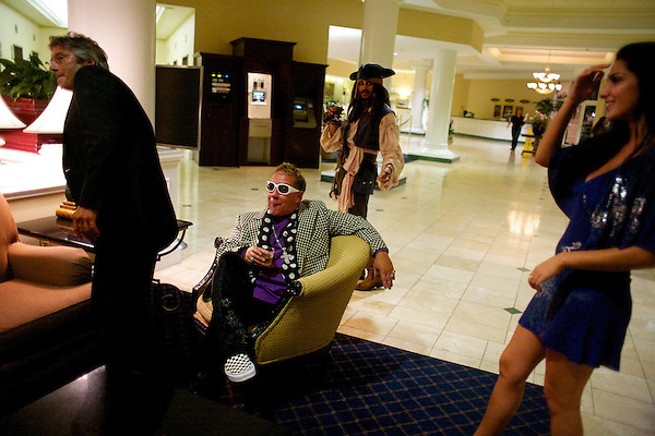 Elton John impersonator looks at Johnny Depp's butt during The Sunburst Convention of Tribute Artists