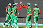 Bangladesh celebrate taking Hamish Gardiner's wicket. ICC Cricket World Cup 2015, Bangladesh v Scotland, 5 March 2015,  Saxton Oval, Nelson, New Zealand, <br /> Photo: Marc Palmano/shuttersport.co.nz