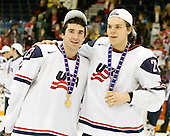 Kyle Palmieri (USA - 23), Jeremy Morin (USA - 26) - Team USA celebrates after defeating Team Canada 6-5 (OT) to win the gold medal in the 2010 World Juniors tournament on Tuesday, January 5, 2010, at the Credit Union Centre in Saskatoon, Saskatchewan.