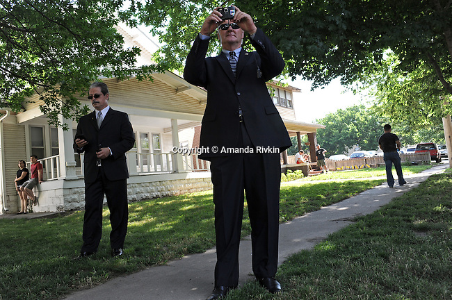 A federal marshall photographs members of controversial preacher Fred Phelps family as they protest across the street against abortion and homosexuality a few blocks outside the College Hill United Methodist Church before the funeral for assassinated abortion doctor George Tiller in Wichita, Kansas on June 6, 2009.  Tiller was gunned down while serving as an usher at his church last Sunday by Scott Roeder, who is now in custody, in a political crime with reverberations across the region and the country; Tiller's Wichita clinic had previously served as a culture wars flashpoint in the 1990s.