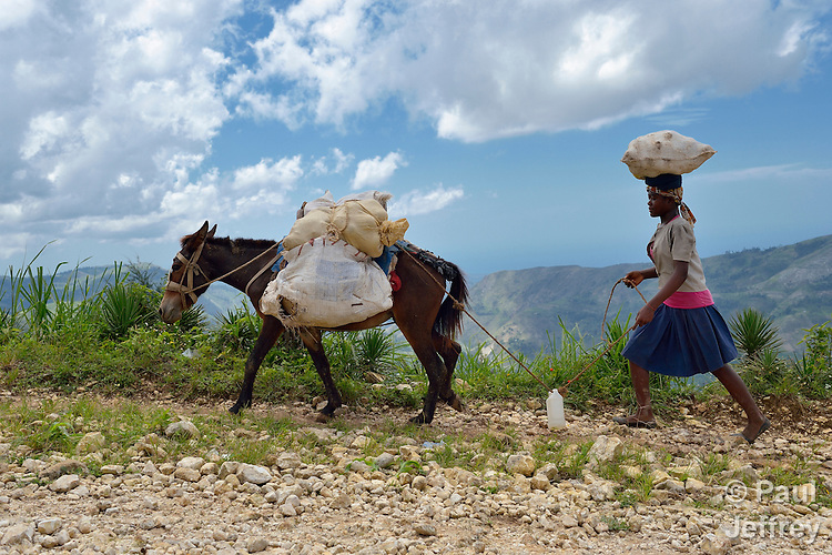 A woman carries goods home from the market in Les Palmes, a rural village in southern Haiti where the Lutheran World Federation has been working with survivors of the 2010 earthquake, along with other residents, to experience more abundant life.