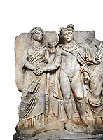 "Roman Sebasteion relief sculpture of emperor Claudius and Agrippina, Aphrodisias Museum, Aphrodisias, Turkey.   Against a white background.<br /> <br /> Claudius in heroic nudity and military cloak shakes hands with his wife Agrippina and is crowned by the Roman people or the Senate wearing a toga. The subject is imperial concord with the traditional Roman state. Agrippina holds ears of wheat: like Demeter goddess of fertility. The emperor is crowned with an oak wreath, the Corona civica or ""citizen crow"", awarded to Roman leaders for saving citizens lives: the emperor id therefore represented as saviour of the people."