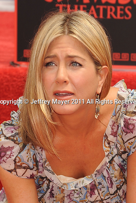 HOLLYWOOD, CA - JULY 07: Jennifer Aniston is honored with a Hand And Footprint Ceremony at Grauman's Chinese Theatre on July 7, 2011 in Hollywood, California.