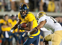 October 6th, 2012: California's Richard Rodgers runs for some yardage during a game at Memorial Stadium, Berkeley, Ca    California defeated UCLA 43 - 17
