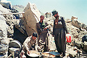 Iraq 1988 .After Anfal, peshmergas of PUK preparing food near the Iranian border.Irak 1988.Peshmergas de l'UPK preparant a manger pres de la frontiiere iranienne, apres l'Anfal