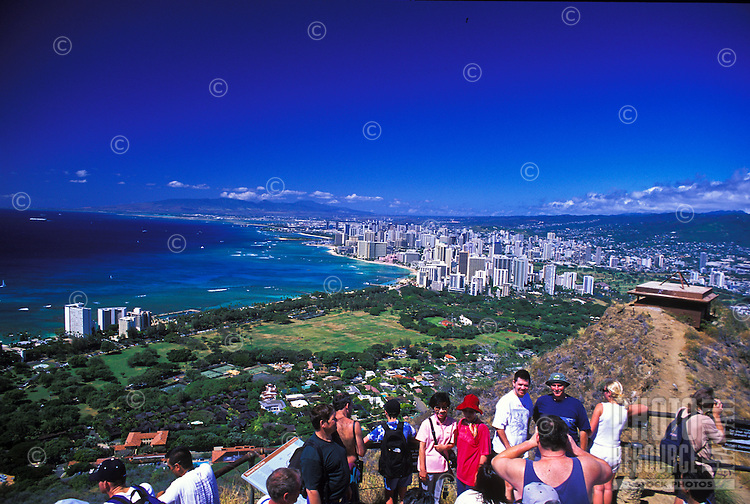 Visitors enjoy the skyline view of Waikiki and surrounding area from atop Diamond Head Crater