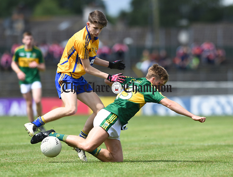 Colin Mc Neilis of Clare in action against Fiáchra Clifford of Kerry during their Minor Munster final at Killarney.  Photograph by John Kelly.