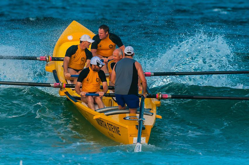 Men rowing boat, Steyne Surf Life Saving Club, Manly Beach, Sydney, New South Wales, Australia