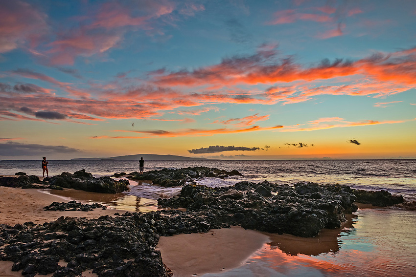 A sunset seen at Kamaole Beach III in Kihei, Maui. The island seen in the distance is Kaho'olawe.