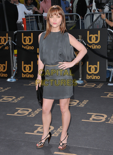 "CHRISTINA RICCI.The Universal Pictures' L.A. Premiere of ""Bruno"" held at the Grauman's Chinese Theatre in Hollywood, California, USA. .June 25th, 2009.full length grey gray sleeveless dress gold belt black clutch bag sandals hand on hip .CAP/DVS.©Debbie VanStory/Capital Pictures."