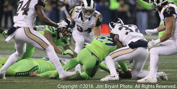 Seattle Seahawks defensive back Neiko Thorpe (27) goes for a loose ball after punter Jon Ryan (9) fumbled after getting hit by Los Angeles Rams defensive back Michael Jordan (35) after running for 26 yards on a fake punt against the at CenturyLink Field in Seattle, Washington on December 15, 2016.  Ryan was shaken up and taken helped from the field. The Seahawks beat the Rams 24-3.  ©2016. Jim Bryant Photo. All Rights Reserved
