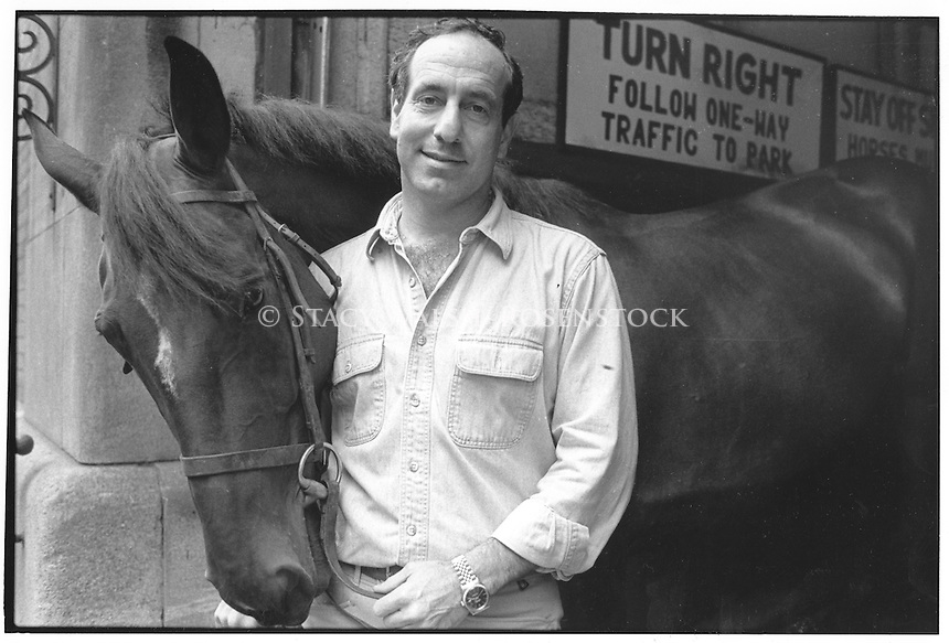 New York, NY August 1988 - Claremont Riding Academy owner Paul Novograd with one of his horses. The stable, which was located at 175 West 89th Street and founded in 1899, was the last remaining equestrian facility in Manhattan.