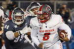 New Mexico quarterback Tevaka Tuioti (8) is chased by Nevada's Hausia Sekona (96) in the first half of an NCAA college football game in Reno, Nev., Saturday, Nov. 2, 2019. (AP Photo/Tom R. Smedes