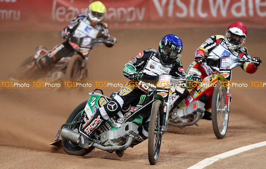 Heat 2: Greg Hancock (blue), Magnus Zetterstrom (red) and Andreas Jonsson (yellow) - British Speedway Grand Prix at the Millennium Stadium, Cardiff - 10/07/10 - MANDATORY CREDIT: Rob Newell/TGSPHOTO - Self billing applies where appropriate - 0845 094 6026 - contact@tgsphoto.co.uk - NO UNPAID USE.