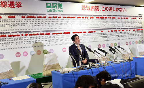 December 14, 2014, Tokyo, Japan - Prime Minister Shinzo Abe gives a TV interview at the headquarters of the ruling Liberal Democratic Party in Tokyo as early returns from Sunday's general election indicate a landslide victory by the LDP on December 14, 2014. The LDP will leky to secure a majority as voters gave Abe a fresh mandate to forge ahead with his economic policy. (Photo by Natsuki Sakai/AFLO) AYF -mis-