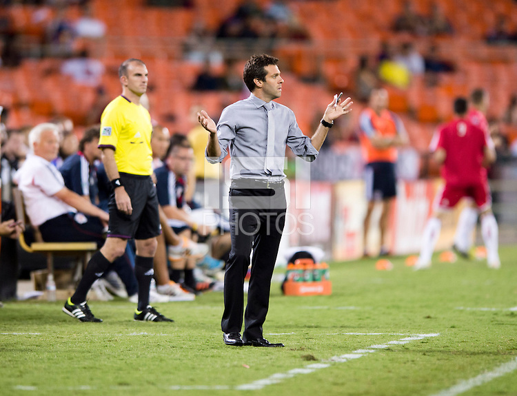 D.C. United head coach Ben Olsen questions a call by the referee during the game at RFK Stadium in Washington, DC.  D.C. United tied the New York Red Bulls, 2-2.
