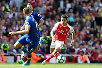 Alexis Sanchez of Arsenal takes onPhil Jagielka of Everton during Arsenal vs Everton, Premier League Football at the Emirates Stadium on 21st May 2017