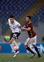 Calcio, Serie A: Roma vs Bologna. Roma, stadio Olimpico, 11 aprile 2016.<br /> Bologna&rsquo;s Sergio Floccari, left, is challenged by Roma&rsquo;s Miralem Pjanic during the Italian Serie A football match between Roma and Bologna at Rome's Olympic stadium, 11 April 2016.<br /> UPDATE IMAGES PRESS/Isabella Bonotto