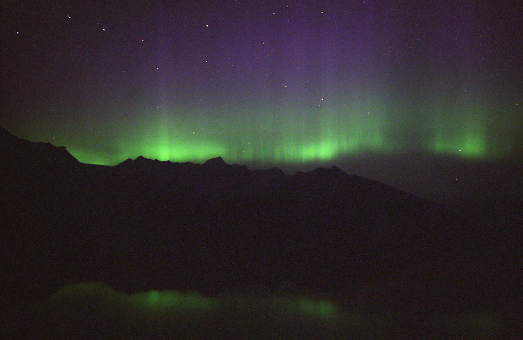 The aurora borealis, or northern lights, fill the sky with the Big Dipper constellation above Prince William Sound near Whittier, Alaska.