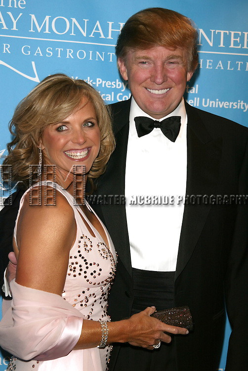 Katie Couric and Donald Trump attending the Star-Studded Benefit, &quot;Some Enchanted Evening&quot;,  for EIF's National Colorectal Cancer Research Alliane and the Jay Monahan Center for Gastrointestinal Health on Cunard's Queen Mary 2 in New York City on <br /> April 24, 2004
