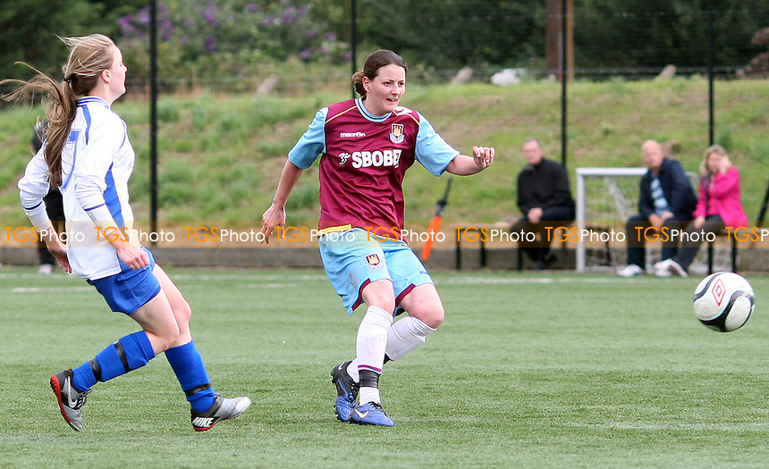 Joanne Wosahlo scores West Ham's 4th goal - West Ham United Ladies vs Enfield Town Ladies, Pre-season Friendly at Chadwell Heath - 15/07/12 - MANDATORY CREDIT: Rob Newell/TGSPHOTO - Self billing applies where appropriate - 0845 094 6026 - contact@tgsphoto.co.uk - NO UNPAID USE.
