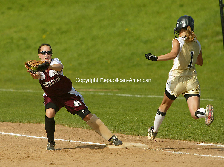 BEACON FALLS, CT 5/10/07- 051007BZ06- Torrington's Sarah Libby (9) make sthe out at first as Woodland's Kristine Swingle (1) runs it out.   <br /> Jamison C. Bazinet Republican-American