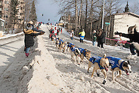 Aliy Zirkle and team run past spectators on the bike/ski trail with an Iditarider in the basket during the Anchorage, Alaska ceremonial start on Saturday, March 5, 2016 Iditarod Race. Photo by O'Hara Shipe/SchultzPhoto.com