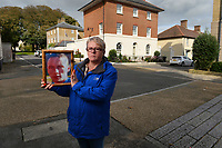 BNPS.co.uk (01202 558833)<br /> Pic: ZacharyCulpin/BNPS<br /> <br /> Tina Cooper holding a picture of her son Richard Hallett at the scene of the tragic accident.<br /> <br /> Prince Charles' Duchy of Cornwall has been accused of defying a coroner after he raised concerns about the safety of the roads in Prince Charles' designer village following the death of a motorcyclist.Dorset Assistant Coroner Brendan Allen wrote to the Duchy of Cornwall calling on them to take 'urgent action' after Richard Hallett, 25, was killed after colliding with a van in Poundbury, Dorset.The inquest heard both parties were travelling at low speed and there was 'a lack of road markings and sightlines' at the fatal junction. Charles' utopian idyll has been specifically designed with winding streets and blind bends to calm traffic, instead of conventional stop signs.Mr Allen, in his report, said the evidence he heard 'gave rise to concern' and that the Duchy of Cornwall must act 'to prevent future deaths'. But he has since received a response from them claiming there is no evidence of a 'clustering of accidents' or 'black spots' in Poundbury.Mr Hallett's mother, Tina Cooper, claimed the Duchy of Cornwall's aversion to road signs demonstrated they put 'the prettiness of the town' above saving lives.