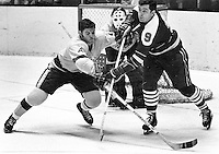 Seals vs Los Angeles Kings, Bill Hicke battles Kings Gilles Marotte, goalie is Denis DeJordy. (1970 photo/Ron Riesterer)