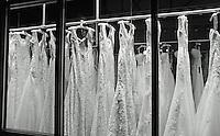 wedding dresses in window on broadway avenue in denver colorado.